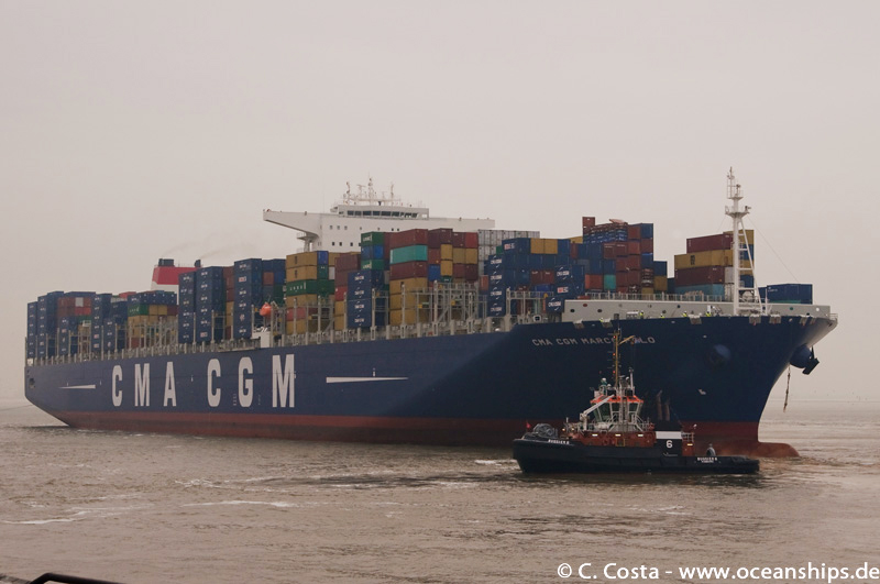 The biggest container vessel ever built! For comparison: the tug boat's length is 27 metres.