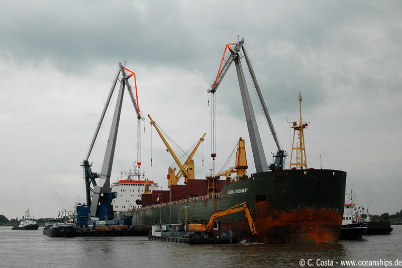 Both cranes had to discharge each coil one by one into barges.